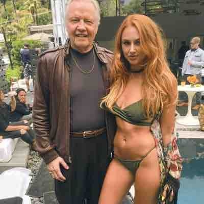 John Voight with one of the girls .