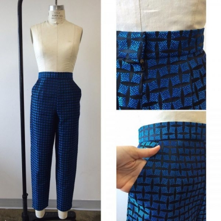 Blue and black brocade pants with lined pockets, waistband, zipper and hook and eye.