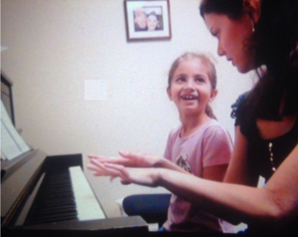 This smart little girl learns so fast! Her parents also take her musical studies very seriously
