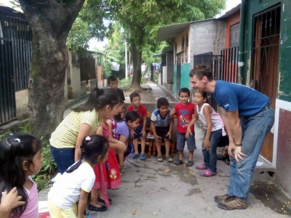 "This is a picture of myself doing an outdoor english class when I lived in El Salvador. We were singing, ""Head, shoulders, knees and toes."""