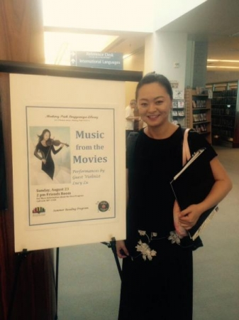 Lucy performing movie music in the library.