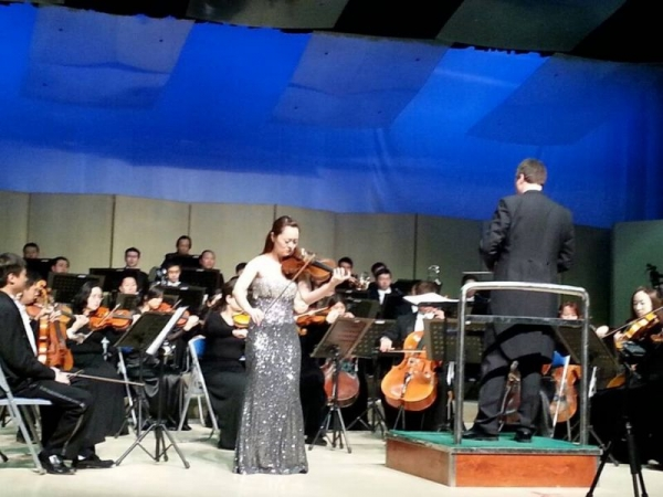 Lucy performing with orchestra in China