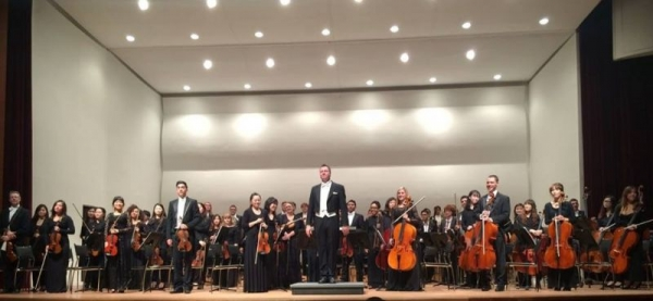 Lucy as concertmaster performing with orchestra in Korea.