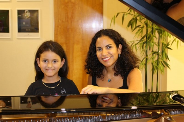 I, Leidys Monascal, Master of Science in Music Education and one of our students