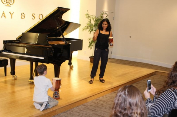 Here I am giving a demonstration of our Brain-Based Musical Games with a student at the Steinway Gallery