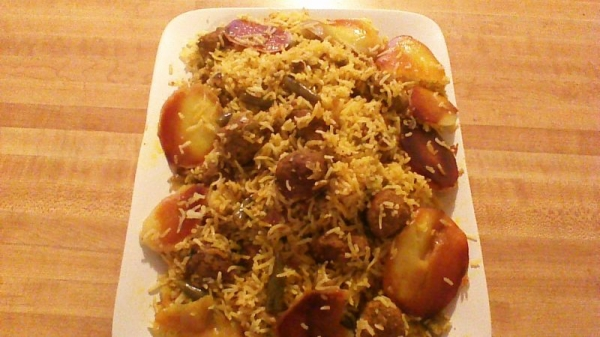 Meatball and Colored delicious rice with potato Tahdeeg