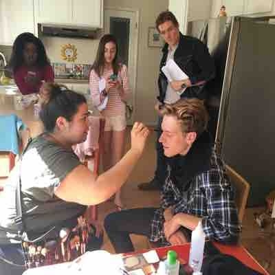 Class takes a break and watches makes up artist prepare Lorenzo Conti for shoot.