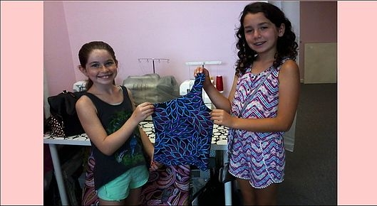 Two of my 12 year old students and the blouse they designed and sewed.