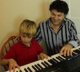 Bob enjoying a lesson with one of his eager piano students.