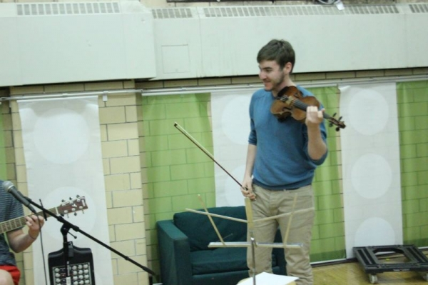 Playing fiddle for a friend