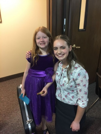 Alexandra and one of her violin students after a successful recital.
