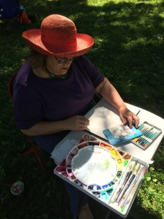 """This is a typical set-up for Jane while she is painting """"en plein air"""" or in the open air----outside! Always exciting to paint outside."""