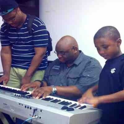 Helping a friend and his son with some chord progressions.