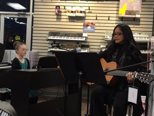 Ms Melody enjoying duets with her student. 