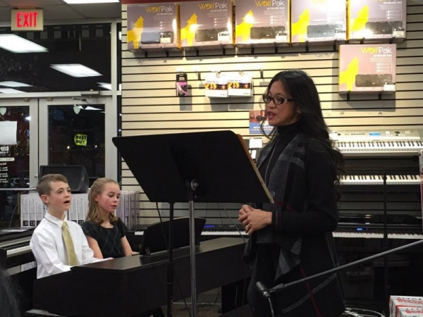 Ms Melody singing America the Beautiful 