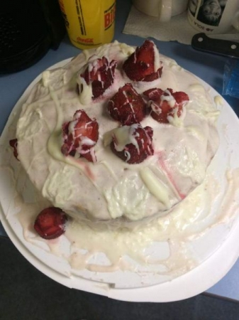 Strawberry cheesecake cake! I am a very messy baker but I love doing it!