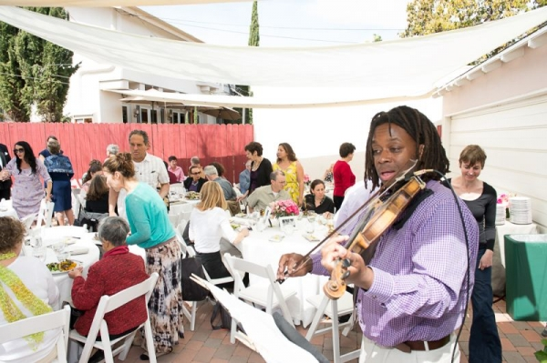 Playing violin at a luncheon.
