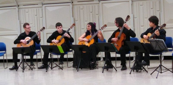 all the way on the left playing in ncc guitar ensemble