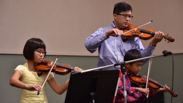 Father, daughter and son ( all 3 of them are my students ) performing at  Xtmas concert ....