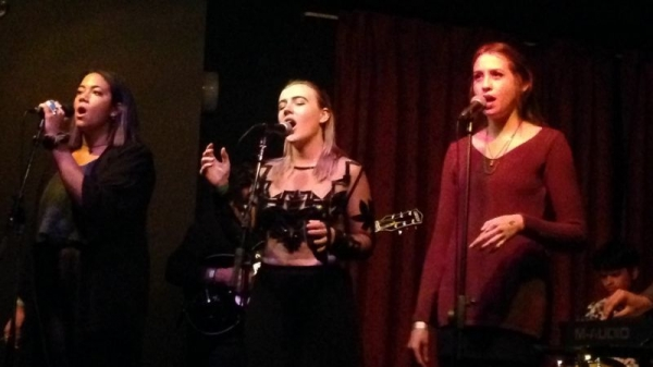 Orla with her backup vocalists that she trained to sing her original music