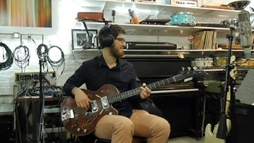 Playing on this vintage bass in the studio in Brooklyn