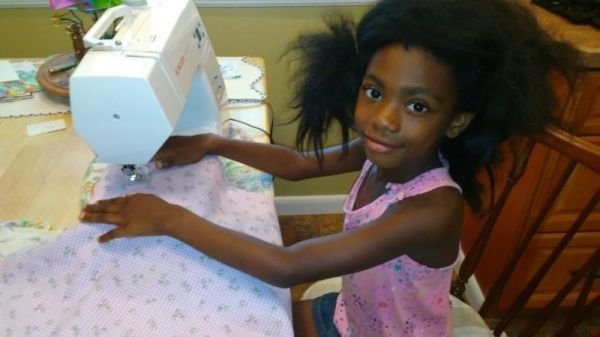 Deja is 7 years old and learning to use the sewing machine.  Today she made a pillowcase.