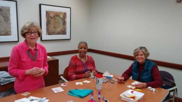 Group origami class...students are making origami cards.