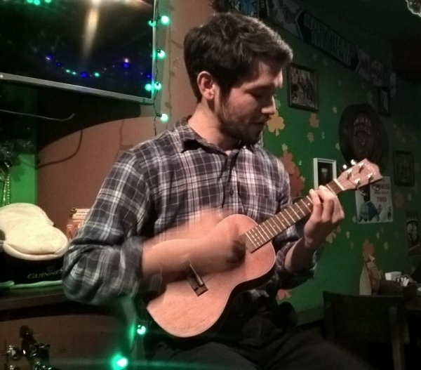 Playing happily on my ukulele.