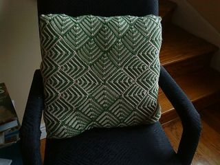 Knitted pillow - mitred squares.