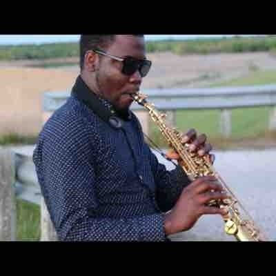 Playing a soprano sax by lake Aquina TX