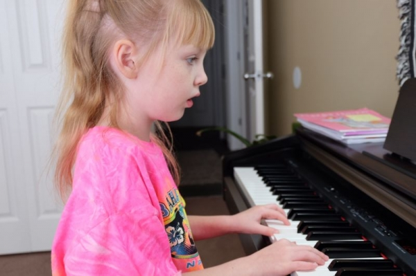 Very well focused practicing her recital pieces.