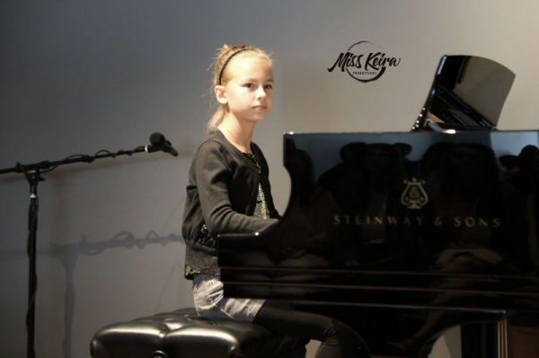 Piano student Anna, performing the Pink Panther Theme and Hungarian Dance No. 5 by Brahms