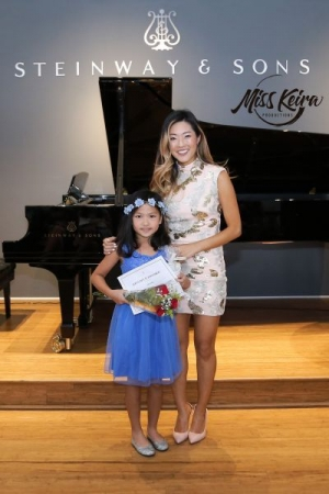 Miss Keira and piano student Chloe, who performed Bill Withers, Lean On Me at her first piano recital.