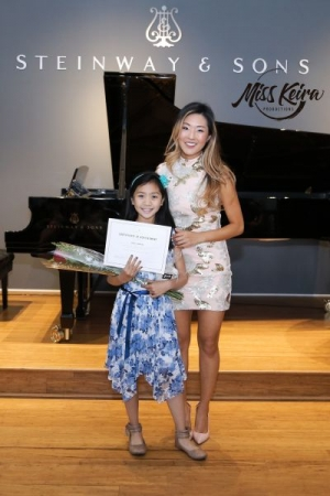 Miss Keira and piano student Geanelle, who performed True Colors by Cyndi Lauper