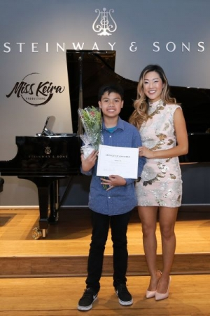 Miss Keira and piano student Jerald, who performed River Flows In You by Yiruma