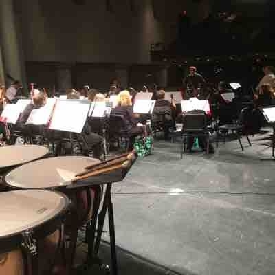 Sitting behind the timpani!