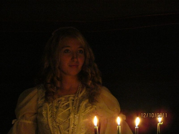 Performing as student director for a Madrigal performance.