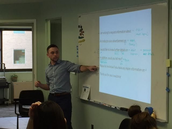 Mike teaching ESL to an intermediate adult class at Teaching House in Washington, DC.