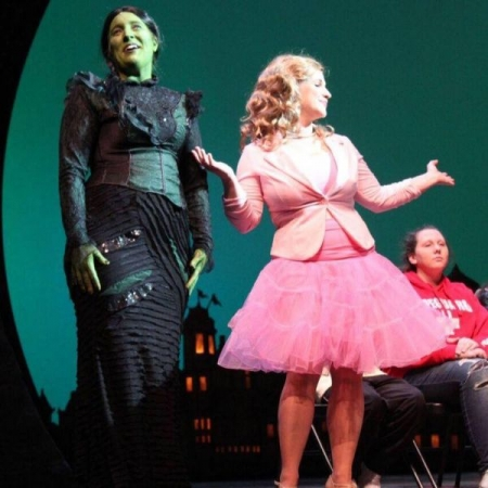 Performing as Glinda in an interactive Wicked workshop on the George Gershwin Broadway stage with StudentsLive Broadway Education Company