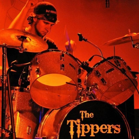 Rocking out on stage with The Tippers!
