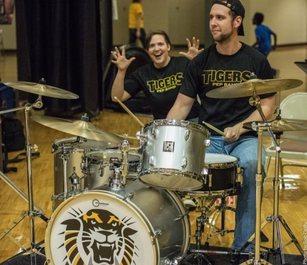 Rocking out with the FHSU Pep Band (with my other drummer friend photo bombing in the back)