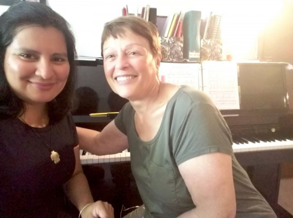 My adult, intermediate piano student and I take a Kodak moment to celebrate her accomplished playing of a contemporary piece on piano.
