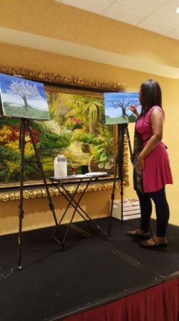 I love teaching. Here, I am instructing lessons on how to paint and providing painting techniques to a group.