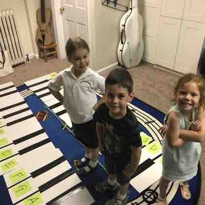 Accomplished kiddos!  Posing after they completed the challenge game in which they raced to put the piano together and then add the letters.