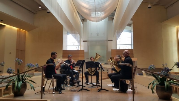 Performing with professional brass quintet, BRASSY!
