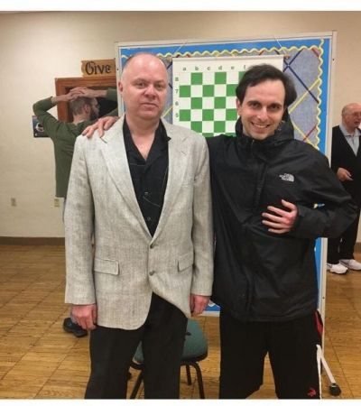 Me with International Master Igor Kheminitsky at the chess simulation at the North Penn Chess Club.