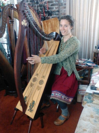"One of my students playing on her ""Shamrock"" harp."