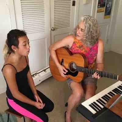 Louise working with vocal student Shania at Hawai'i School of Voice studio.