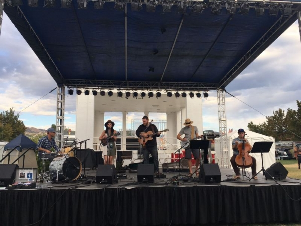 Onstage with Caitlin's favorite new project - folk-rock band, The Backyard Revival. Here they are playing at the Utah State Fair.