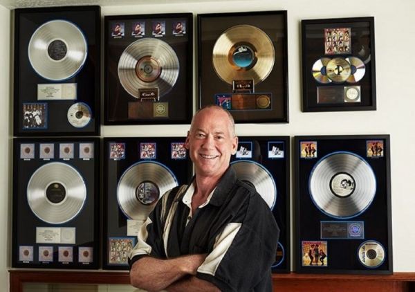 Brad Chapman in front of his platinum wall